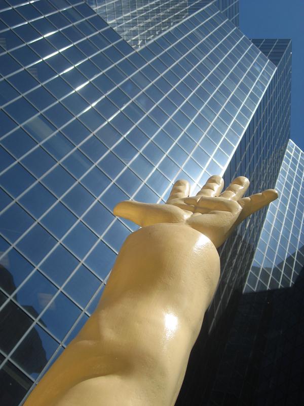hand and modern skyscraper