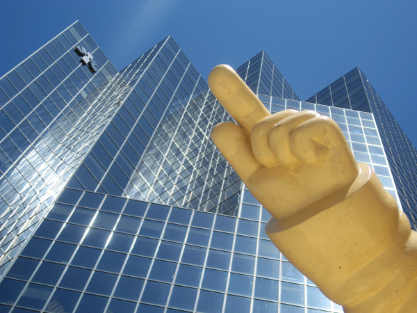 hand and modern skyscraper
