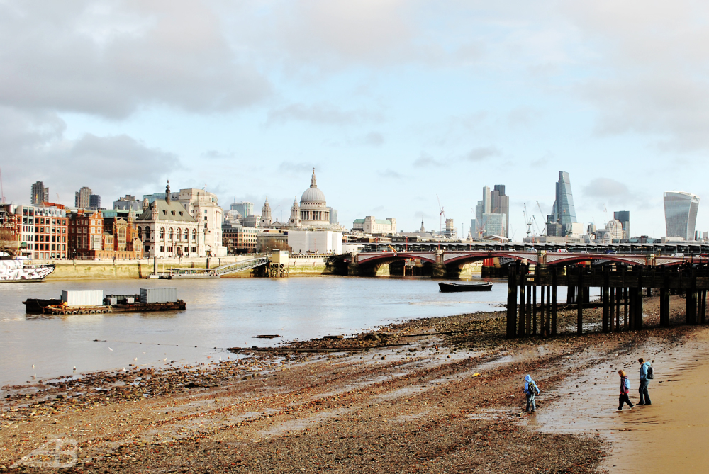 People on the Thames foreshore, London