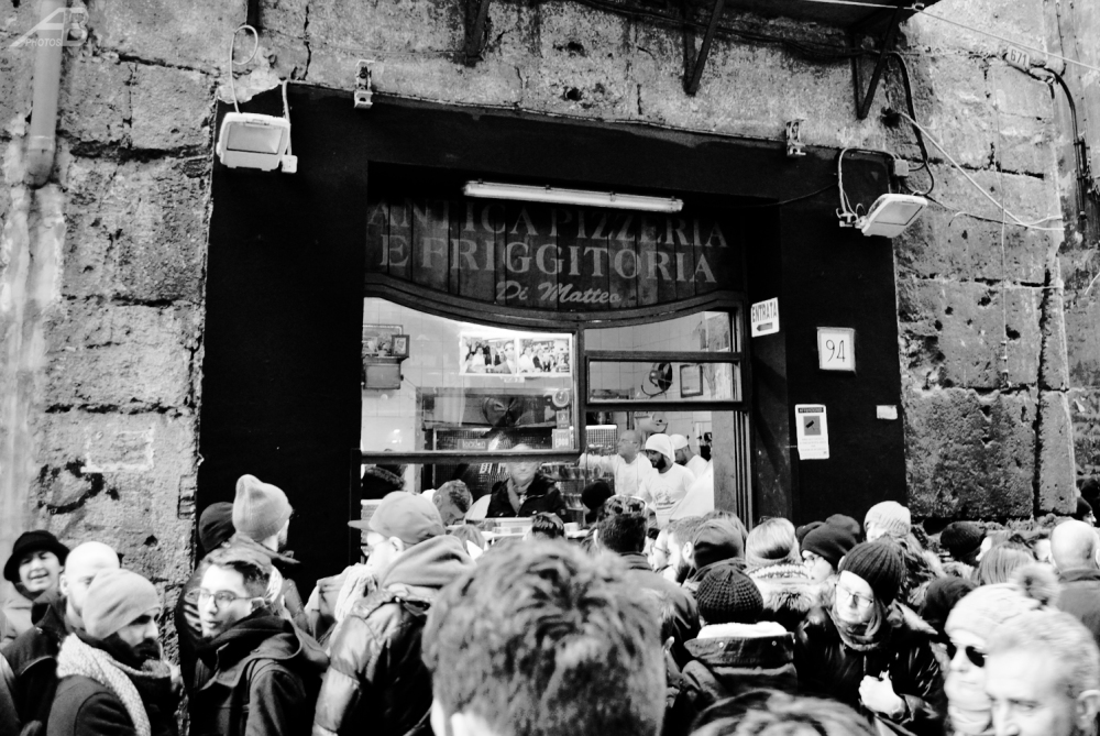 People queuing for pizza, Naples, Italy