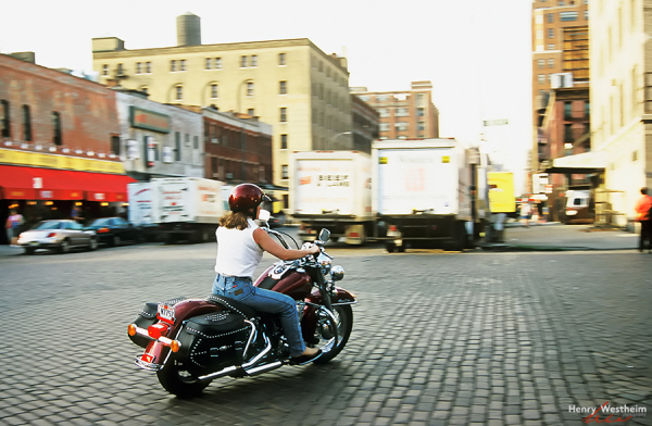 Woman riding a Harley Davidson motorcycle NYC USA
