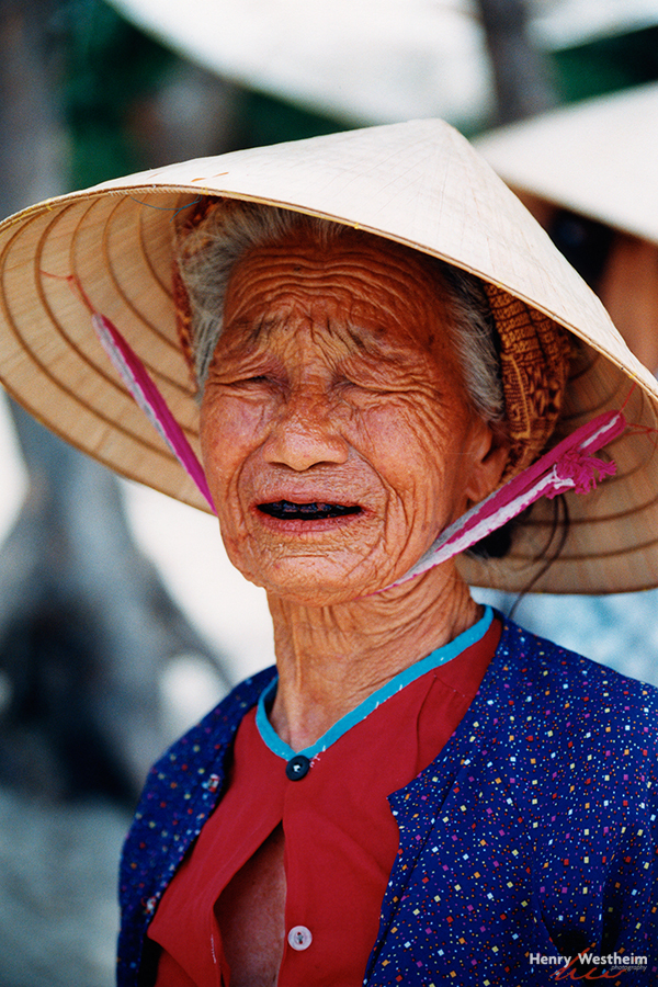 Elderly Vietnamese woman on China Beach, Vietnam