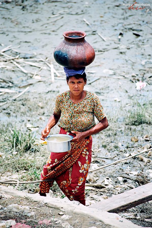 Myanmar Burma Mandalay Woman carrying water head