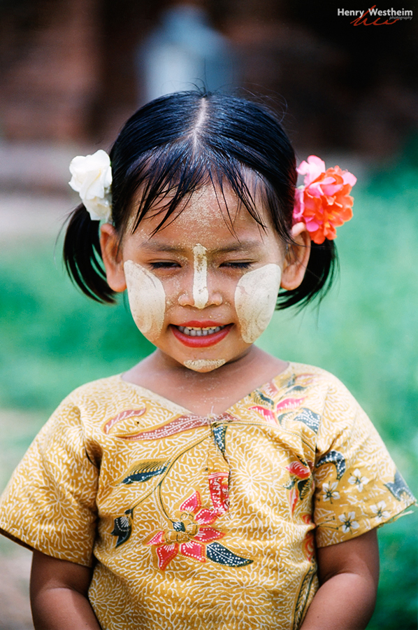 Myanmar Burma young girl thanaka face markings