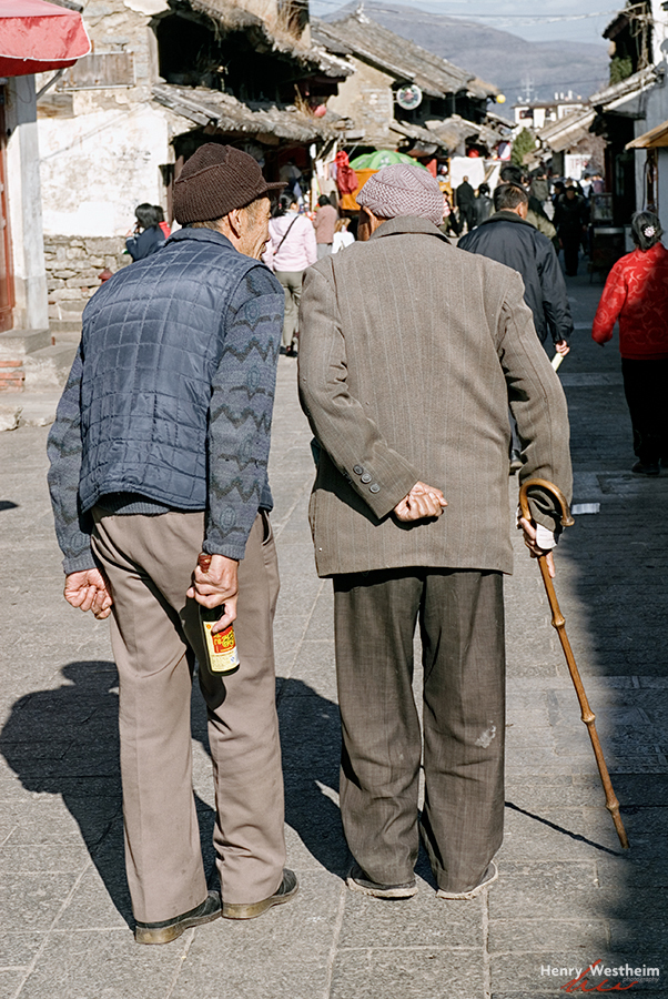 old Chinese men walking talking street Dali China