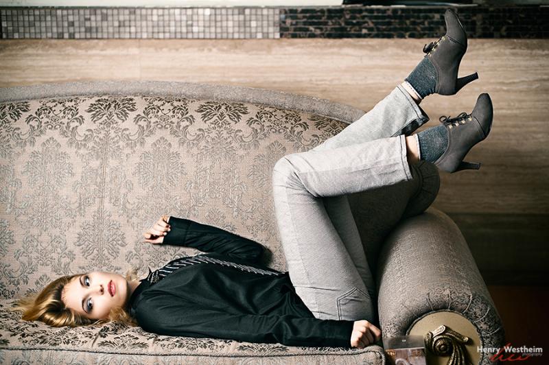 Young Caucasian woman lady laying relaxing sofa