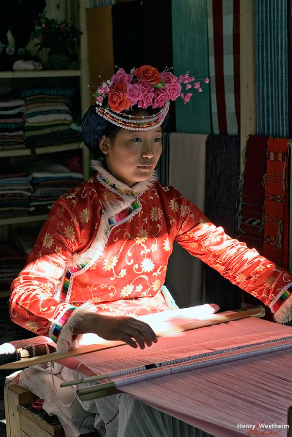 Chinese Naxi woman weaving, Lijiang Old Town China