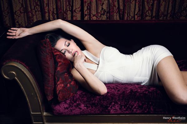 Beautiful sexy young Caucasian young woman on sofa