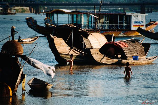 Vietnam, Hue, Children bathing in Perfume River