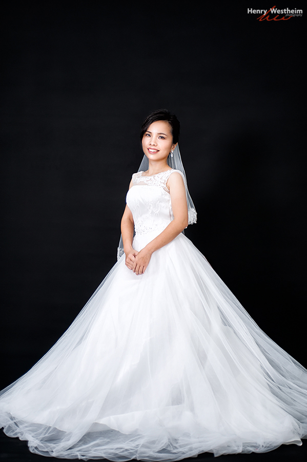 Young Asian woman wedding gown portrait