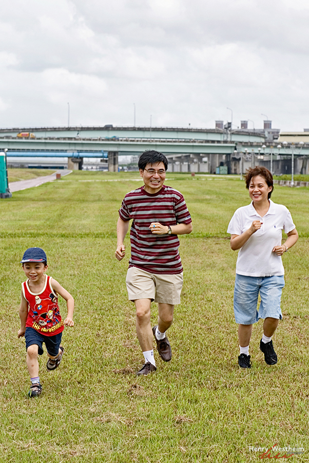Asian family having fun outdoors in park, Taiwan