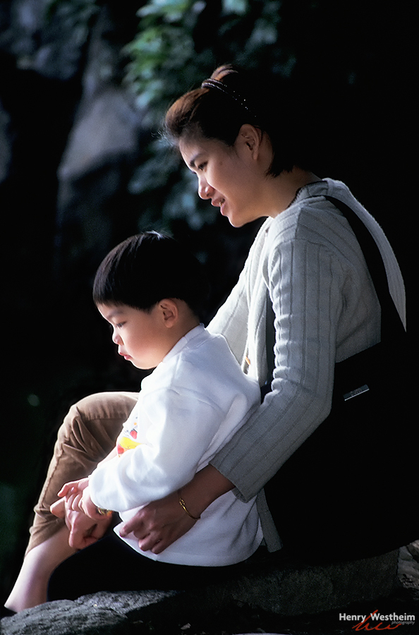Asian mother and son outdoors