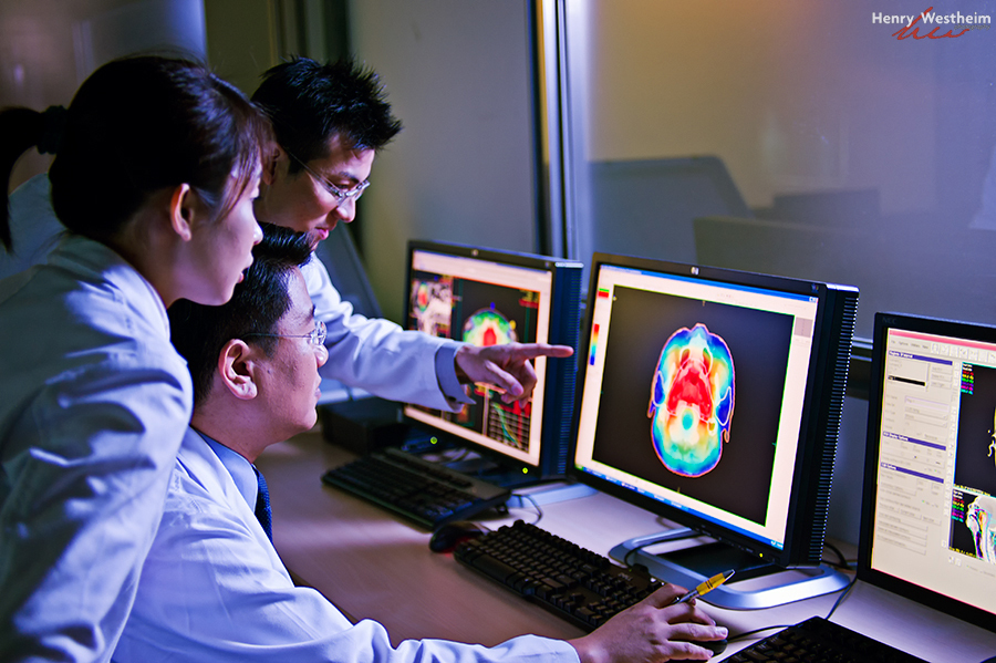 Doctors viewing and discussing CT scan results
