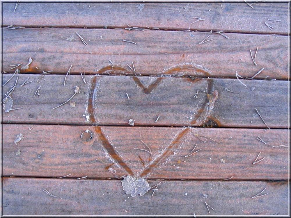 a heart drawn on a frozen table
