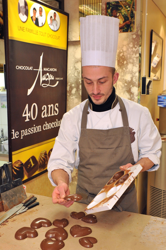 a young man is preparing chocolate specialities