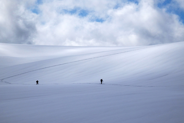 two snowshoes enthusiasts in a snowy landscape