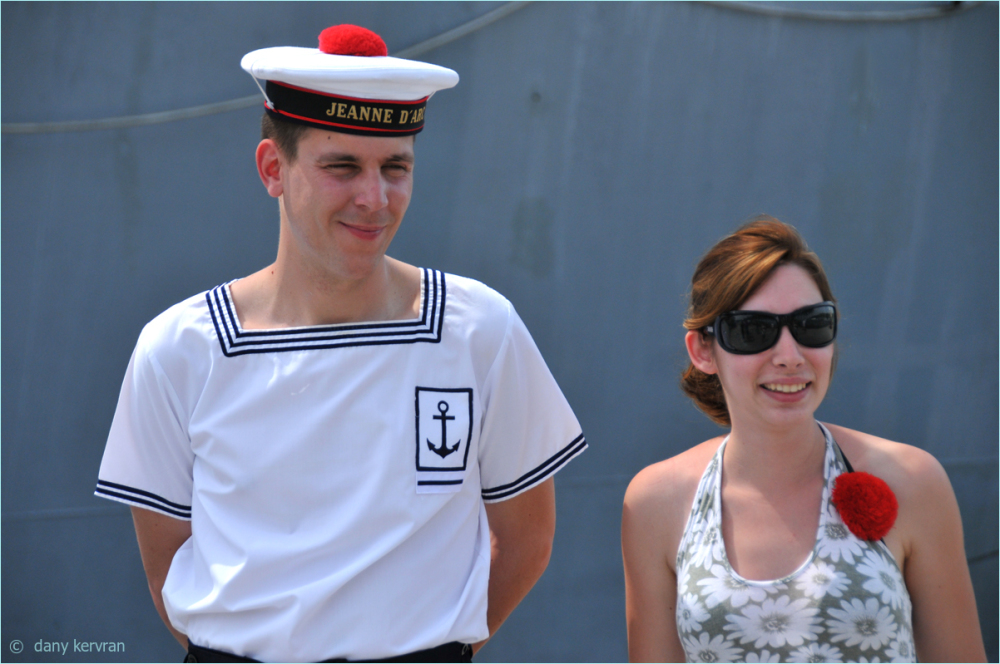 a seaman of the French Navy poses with an admirer