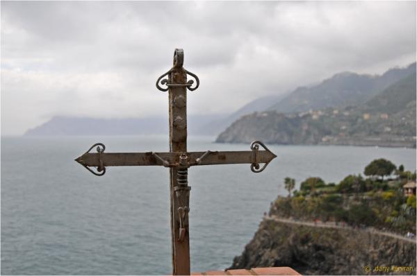 christian cross and view towards Corniglia