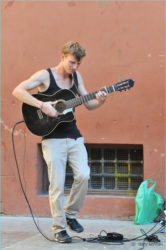 Granada : a guitarist plays flamenco