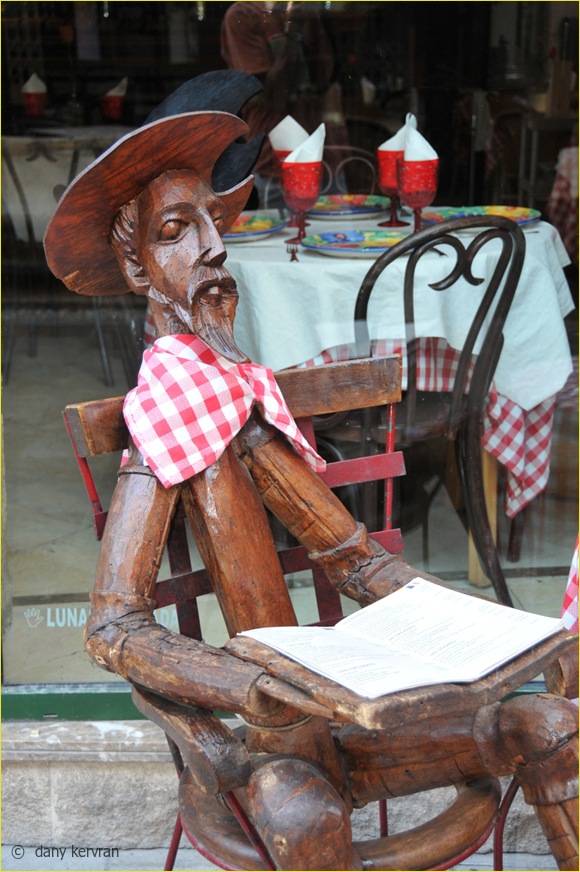 a wooden Don Quixote shows a menu