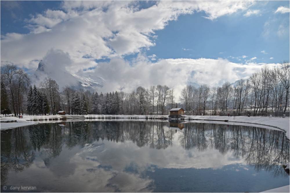 Blue lake in Morillon in winter season