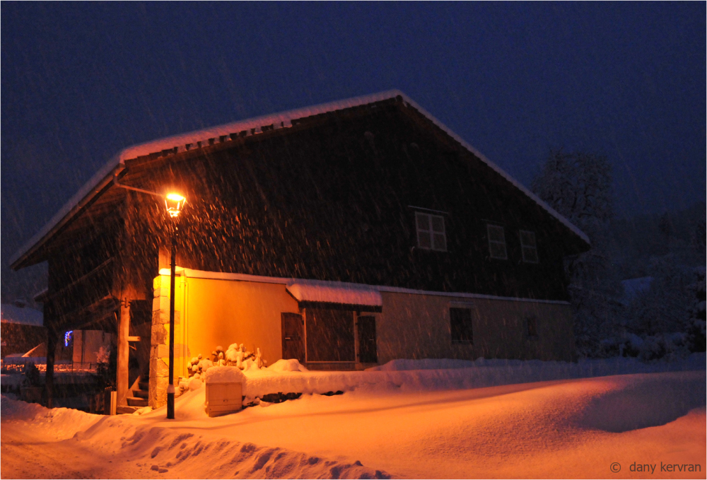 house under snowfall in Morillon