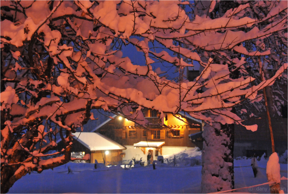 a chalet in snowy landscape