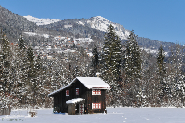 small chalet in the snow