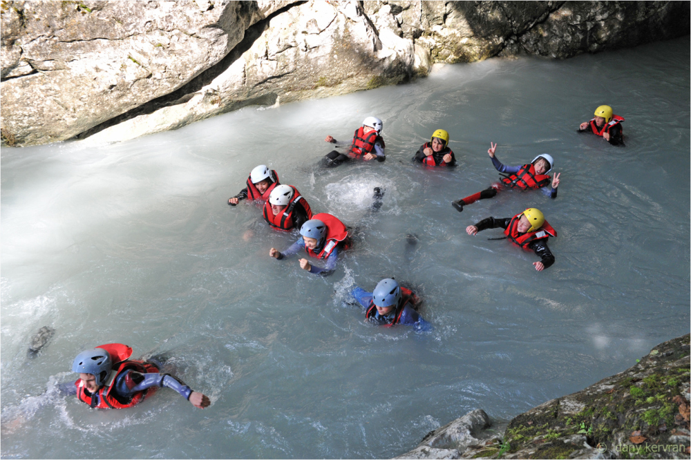 kids swimming while a rafting expedition