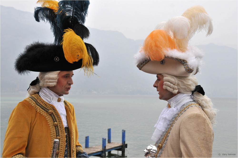 two men dressed with ancient clothes for Carnival