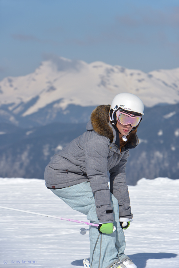 a woman skiing downhill
