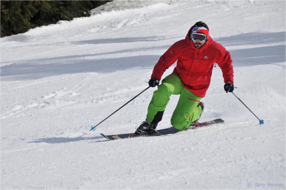 a skier practises Telemark skiing