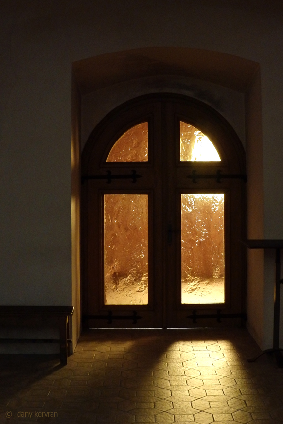 door of a church illuminated by the sun