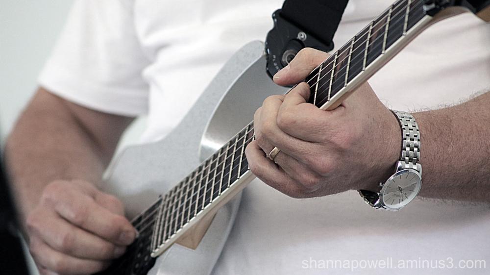 Guitarist's hands on fretboard