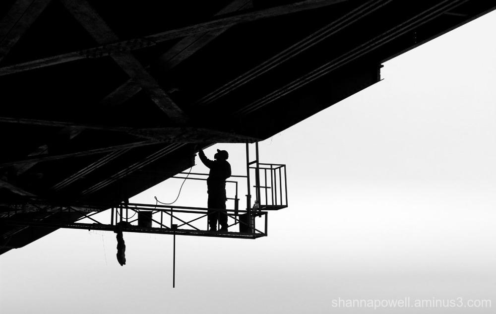 Construction worker repairing bridge