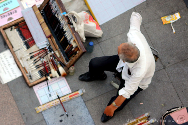 Calligraphy artist at the market