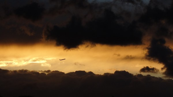 Plane among the clouds .Sunset
