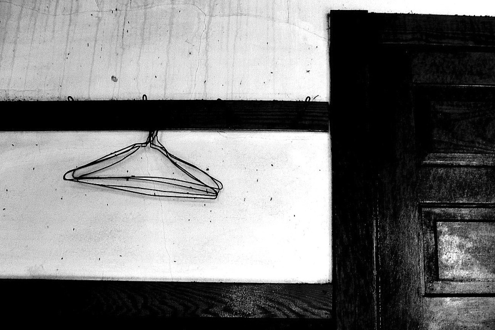 Coat hangers old dance hall.