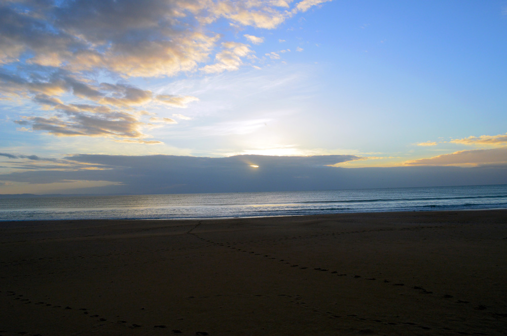 Sunrise through Cloudy Sky Jeffreys Bay Beach