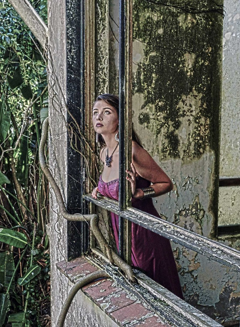 Model at window of Cape Hermes hotel