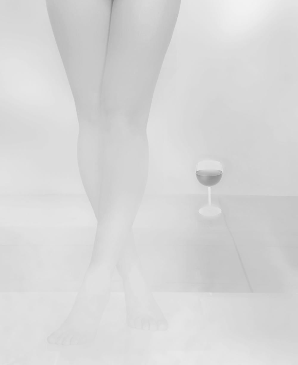 Woman's legs in shower mist