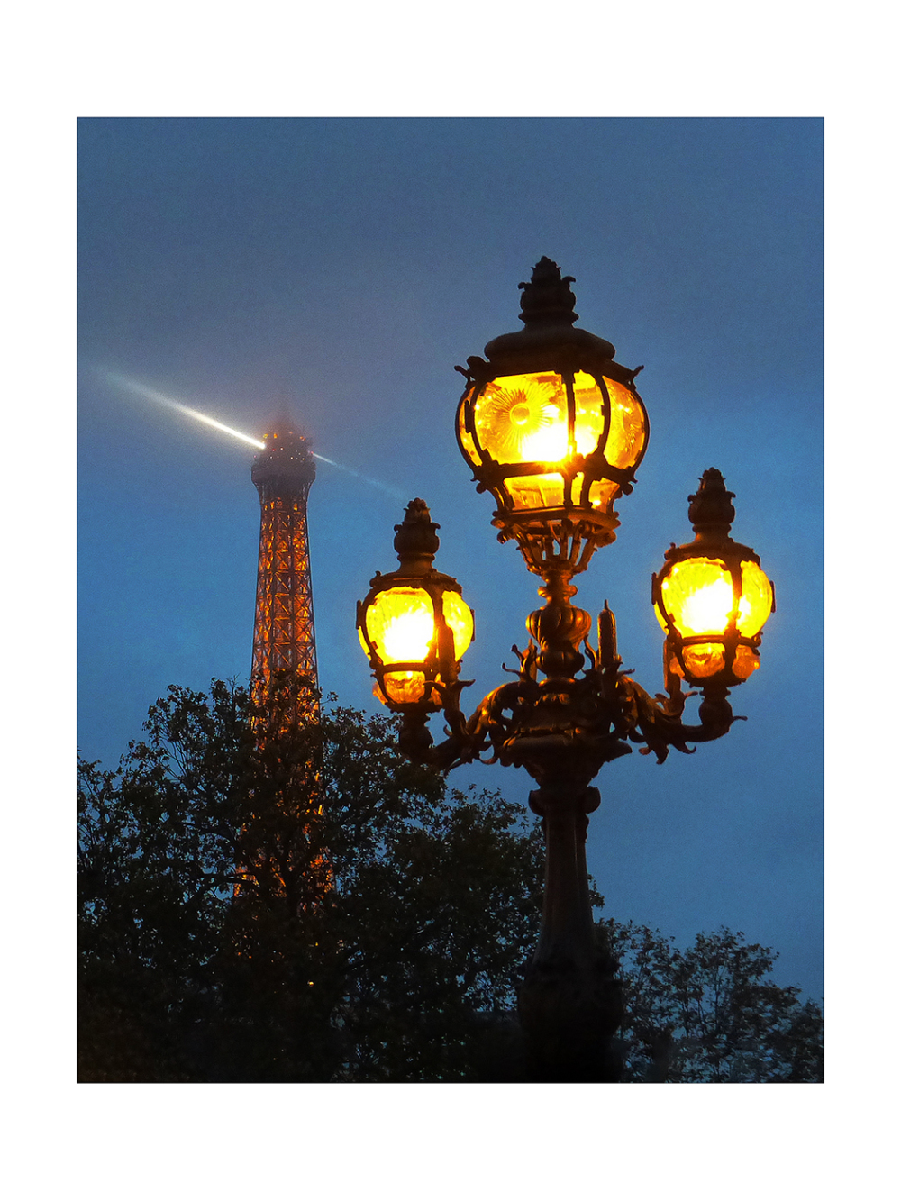 Paris streetlight with Eiffel Tower in cloud