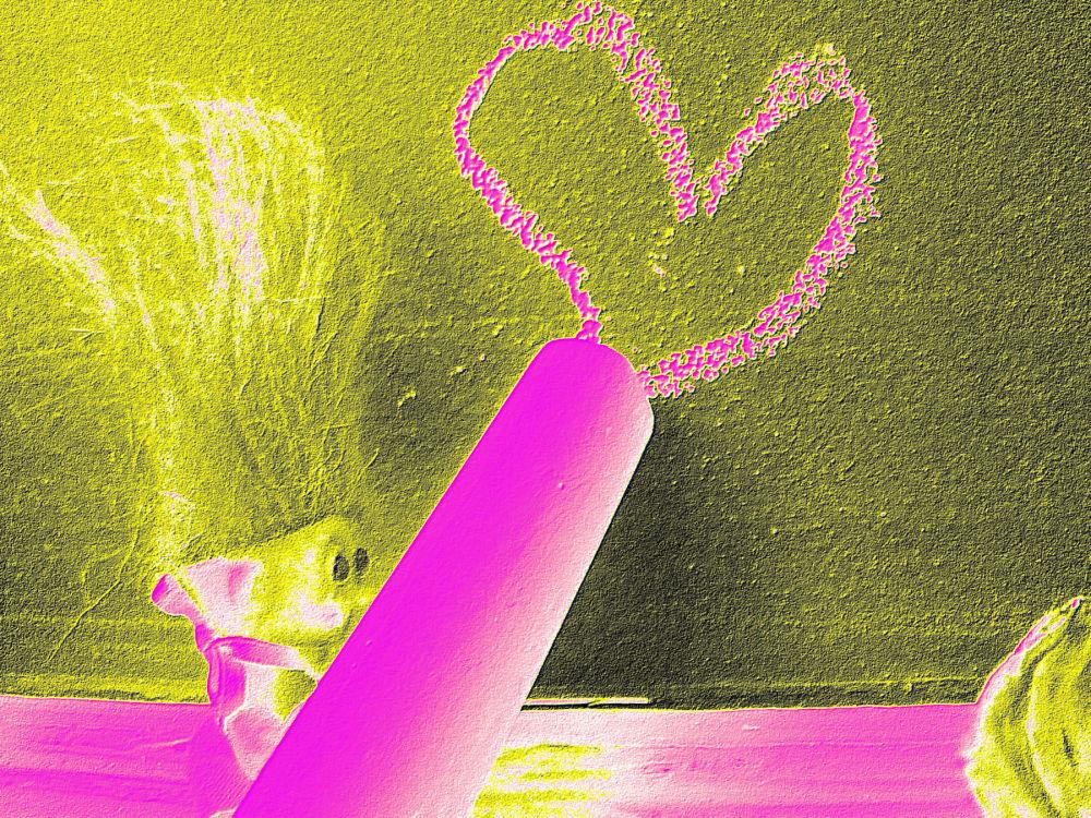 Troll Doll drawing a heart in chalk