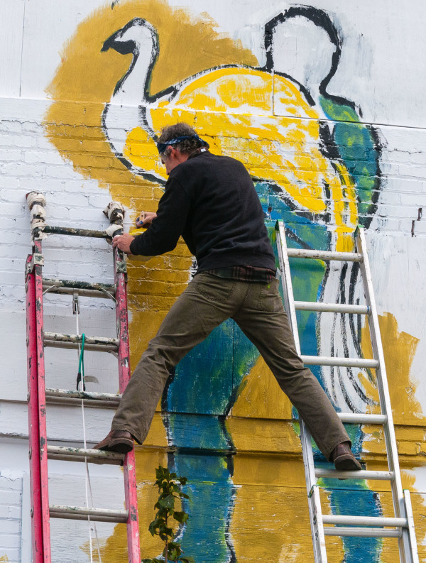 Artist working on a city mural