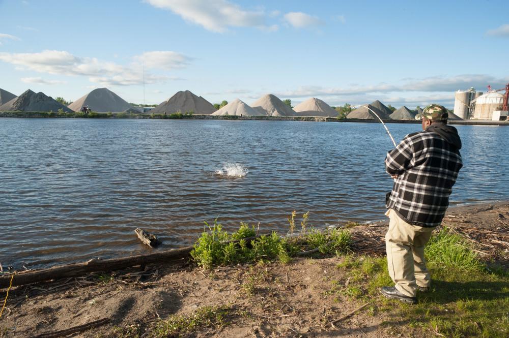 fisherman bringing in a big ld fish