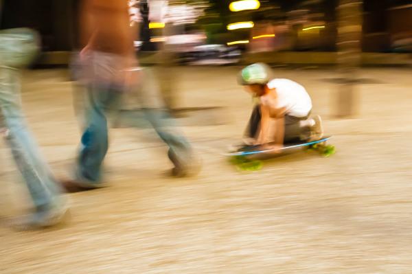 young boy riding a skate board