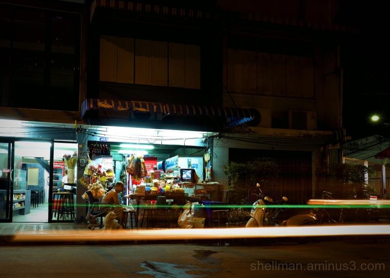 Dog and owner on a Bangkok side street