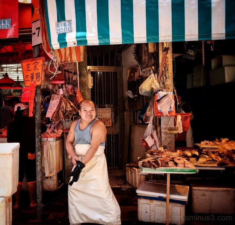 Cheerful fishmonger in Causeway Bay