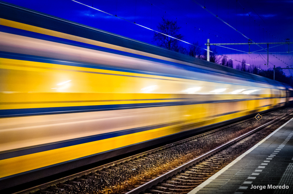 Yellow intercity train at night