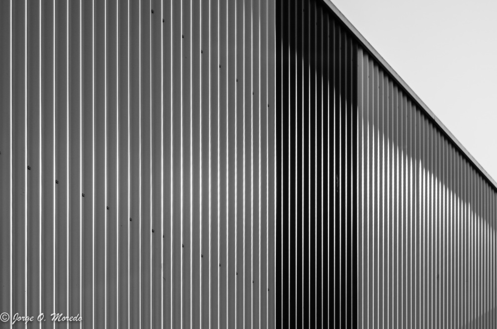 Black and white picture of metal wall